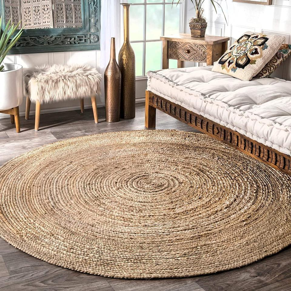 """This neutral, natural-looking rug will make a statement wherever you lay it down. It has a braided texture that's better to clean by shaking off rather than vacuuming over.<a href=""""https://amzn.to/3jbsjbl"""" target=""""_blank"""" rel=""""noopener noreferrer"""">Find it for $36 at Amazon</a>."""