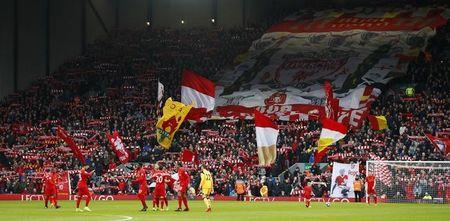General view as Liverpool fans unveil a banner