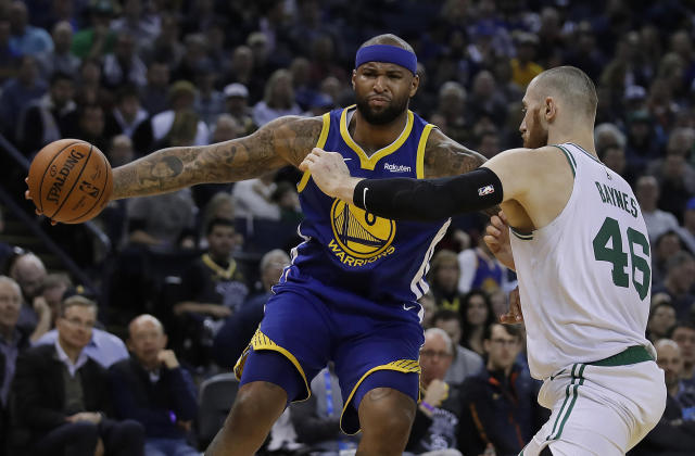 Golden State Warriors' DeMarcus Cousins, left, drives the ball against Boston Celtics' Aron Baynes (46) during the first half of an NBA basketball game Tuesday, March 5, 2019, in Oakland, Calif. (AP Photo/Ben Margot)