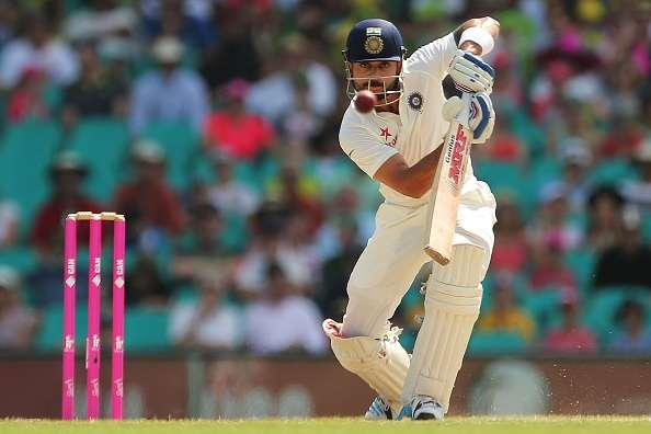 SYDNEY, AUSTRALIA - JANUARY 09: Virat Kohli of India plays a cover drive during day four of the Fourth Test match between Australia and India at Sydney Cricket Ground on January 9, 2015 in Sydney, Australia. (Photo by Brendon Thorne/Getty Images)