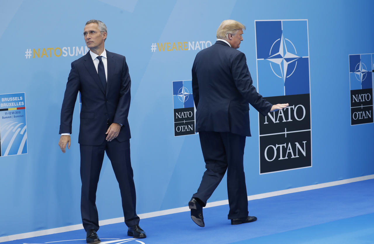 <p>President Trump gestures as he walks away after being greeted by NATO Secretary-General Jens Stoltenberg, left, before a summit of heads of state and government at NATO headquarters in Brussels on Wednesday, July 11, 2018. NATO leaders gathered in Brussels for a two-day summit to discuss Russia, Iraq and their mission in Afghanistan. (Photo: Pablo Martinez Monsivais/AP) </p>