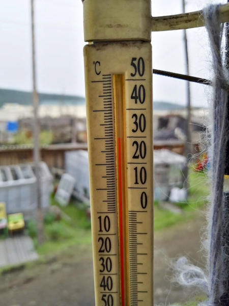 In this handout photo taken Sunday, June 21, 2020 and provided by Olga Burtseva, an outside thermometer shows 30 Celsius (86 F) around 11 p.m in Verkhoyansk, the Sakha Republic, about 4660 kilometers (2900 miles) northeast of Moscow, Russia. A record-breaking temperature of 38 degrees Celsius (100.4 degrees Fahrenheit) was registered in the Arctic town of Verkhoyansk on Saturday, June 20 in a prolonged heatwave that has alarmed scientists around the world. (Olga Burtseva via AP)