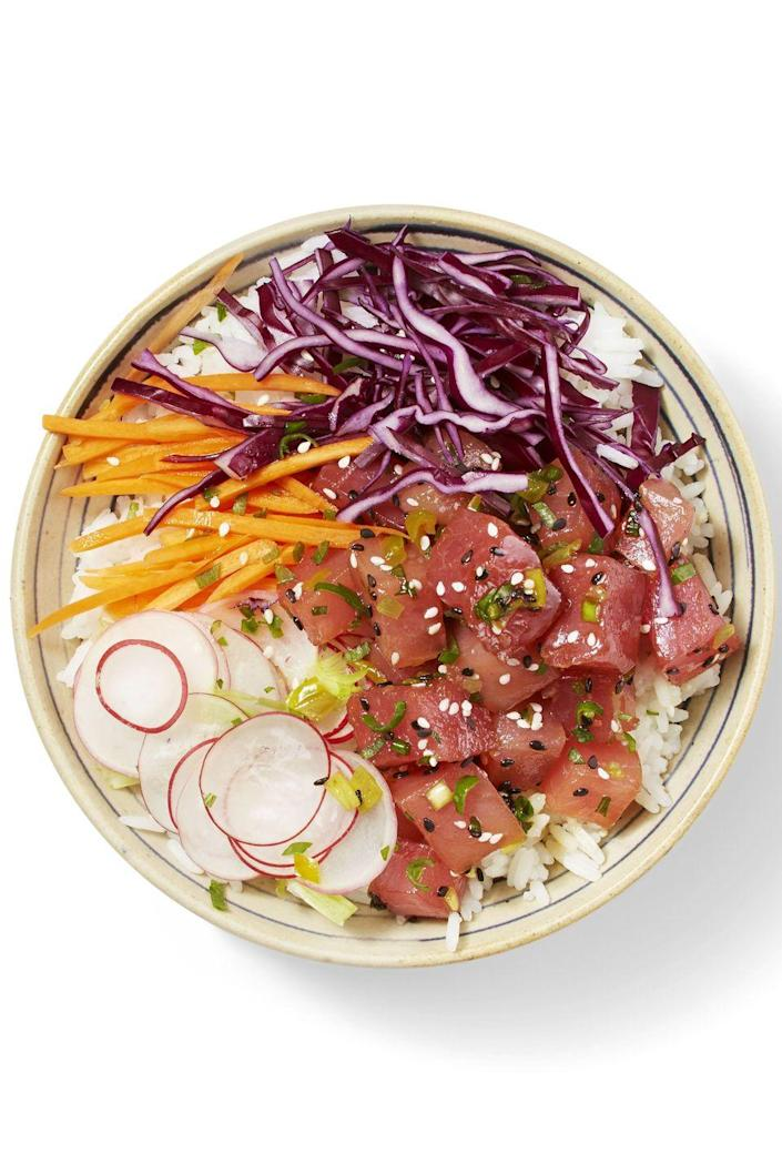 """<p>This poke bowl only takes 15 minutes to make — much faster than it takes to hop on a plane to a tropical island! </p><p><em><a href=""""https://www.goodhousekeeping.com/food-recipes/a38844/hawaiian-tuna-bowl-recipe/"""" rel=""""nofollow noopener"""" target=""""_blank"""" data-ylk=""""slk:Get the recipe for Hawaiian Tuna Bowl »"""" class=""""link rapid-noclick-resp"""">Get the recipe for Hawaiian Tuna Bowl »</a></em></p>"""