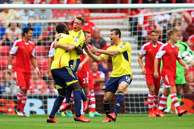 SOUTHAMPTON, ENGLAND - AUGUST 24: Emanuele Giaccherini (C) of Sunderland celebrates with teammates after scoring the opening goal during the Barclays Premier League match between Southampton and Sunderland at St Mary's Stadium on August 24, 2013 in Southampton, England. (Photo by Clive Rose/Getty Images)