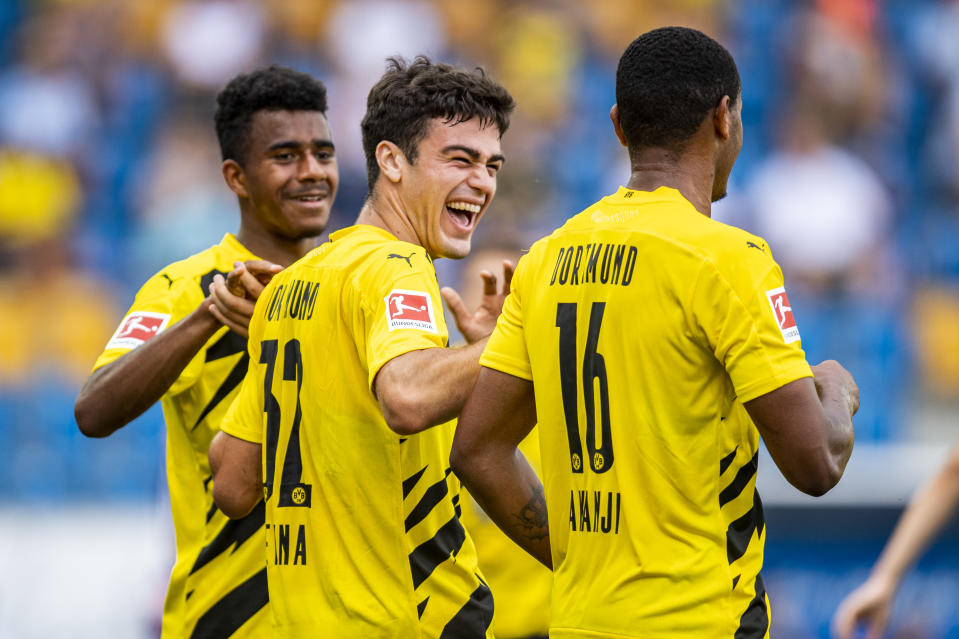 From left, Dortmund's Ansgar Knauff, Giovanni Reyna and Manuel Akanji celebrate after a goal.