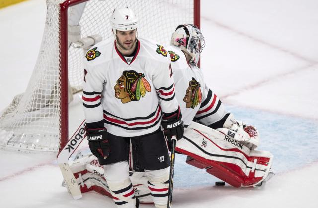 Chicago Blackhawks' Brent Seabrook and Corey Crawford react following a goal by Montreal Canadiens' Andrei Markov during overtime of an NHL hockey game Saturday, Jan. 11, 2014, in Montreal. The Canadiens won 2-1. (AP Photo/The Canadian Press, Paul Chiasson)