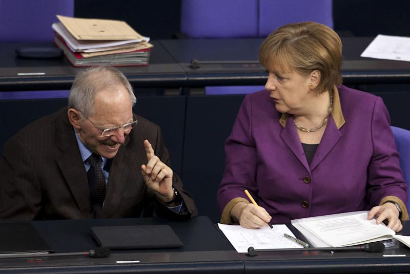 Euro leaders delay decision on bigger bailout fund