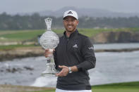 Daniel Berger poses with his trophy on the 18th green of the Pebble Beach Golf Links after winning the AT&T Pebble Beach Pro-Am golf tournament Sunday, Feb. 14, 2021, in Pebble Beach, Calif. (AP Photo/Eric Risberg)