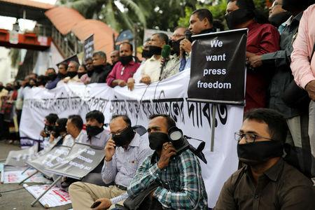 Journalists hold banners and placards as they protest against the newly passed Digital Security Act in front of the Press Club in Dhaka, Bangladesh, October 11, 2018. REUTERS/Mohammad Ponir Hossain