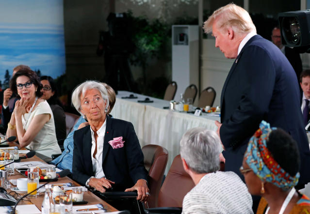 <p>President Donald Trump arrives as Managing Director of the International Monetary Fund Christine Lagarde looks up while they attend a G7 and Gender Equality Advisory Council meeting as part of a G7 summit in the Charlevoix city of La Malbaie, Canada, June 9, 2018. (Photo: Yves Herman/Reuters) </p>