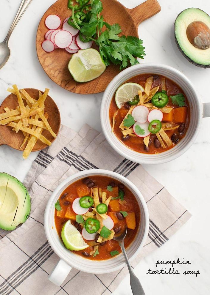 """<p>This smoky tortilla soup gets its flavor from dried chipotle chili peppers, fresh pumpkin and roasted tomatoes—but it's the toppings we love the most! Try crispy tortilla strips, avocado, and a squeeze of lime juice. </p><p><strong>Get the recipe at <a href=""""https://www.loveandlemons.com/pumpkin-tortilla-soup/"""" rel=""""nofollow noopener"""" target=""""_blank"""" data-ylk=""""slk:Love and Lemons"""" class=""""link rapid-noclick-resp"""">Love and Lemons</a>. </strong> </p>"""