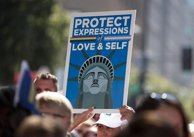 "<p>A person holds up a sign that reads 'Protect Expressions of Love & Self"" during the Equality March for Unity and Pride in Washington, Sunday, June 11, 2017. (Photo: Carolyn Kaster/AP) </p>"
