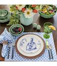 """<p>""""My favorite thing about setting our table at Easter is all of the color we can infuse into the space. From the linens to the dyed eggs, I always enjoy pulling colors from the beautiful flowers that mark the beginning of spring."""" <em>—<a href=""""https://www.reidycreative.com/"""" rel=""""nofollow noopener"""" target=""""_blank"""" data-ylk=""""slk:Tiffanni Reidy"""" class=""""link rapid-noclick-resp"""">Tiffanni Reidy</a>, Interior and Commercial Designer</em></p><p><a class=""""link rapid-noclick-resp"""" href=""""https://go.redirectingat.com?id=74968X1596630&url=https%3A%2F%2Fwww.dillards.com%2Fp%2Fsouthern-living-easter-collection-cabbage-salt--pepper-set%2F510437722&sref=https%3A%2F%2Fwww.elledecor.com%2Fdesign-decorate%2Fg2967%2Feaster-table-decor%2F"""" rel=""""nofollow noopener"""" target=""""_blank"""" data-ylk=""""slk:Shop this Tablescape"""">Shop this Tablescape </a></p>"""