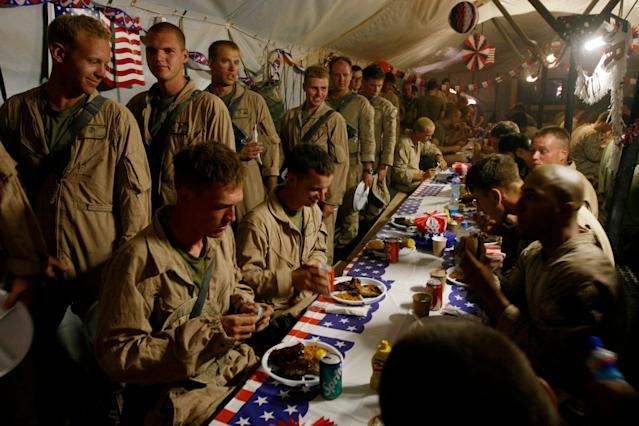 <p>U.S. Marines, from the 24th Marine Expeditionary Unit, have a special lunch to celebrate the Fourth of July at a forward operating base in southern Afghanistan, Friday, July 4, 2008. (Photo: Rafiq Maqbool/AP) </p>