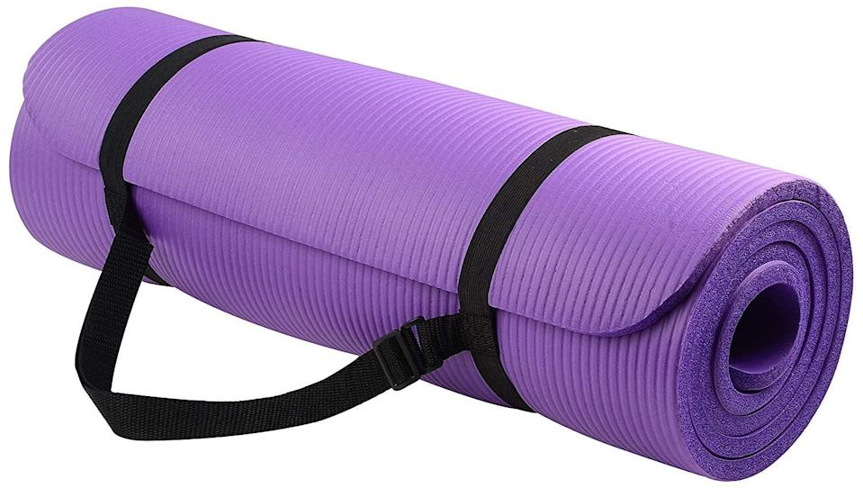 """<p>This <a href=""""https://www.popsugar.com/buy/BalanceFrom-GoYoga-All-Purpose-Extra-Thick-Exercise-Mat-472138?p_name=BalanceFrom%20GoYoga%20All-Purpose%20Extra%20Thick%20Exercise%20Mat&retailer=amazon.com&pid=472138&price=16&evar1=fit%3Aus&evar9=46418649&evar98=https%3A%2F%2Fwww.popsugar.com%2Fphoto-gallery%2F46418649%2Fimage%2F46418915%2FBalanceFrom-GoYoga-All-Purpose-Extra-Thick-Exercise-Mat&list1=shopping%2Cfitness%20gear%2Chome%20workouts%2Cfitness%20shopping&prop13=api&pdata=1"""" class=""""link rapid-noclick-resp"""" rel=""""nofollow noopener"""" target=""""_blank"""" data-ylk=""""slk:BalanceFrom GoYoga All-Purpose Extra Thick Exercise Mat"""">BalanceFrom GoYoga All-Purpose Extra Thick Exercise Mat</a> ($16) is an Amazon bestseller with more than 16,000 rave reviews.</p>"""