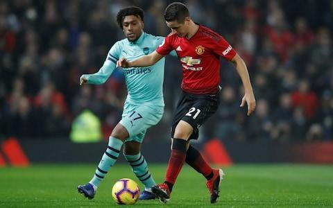 <span>Manchester United's Ander Herrera in action with Arsenal's Alex Iwobi</span> <span>Credit: Action Images via Reuters/Carl Recine </span>