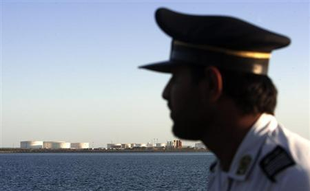 A member of security personnel looks on at oil docks at the port of Kalantari in the city of Chabahar