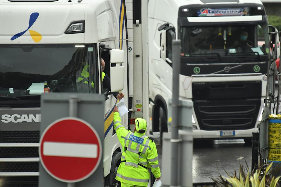 A police officer checks a driver's Covid-19 test documentation at the entrance to the Port of Dover, southeast England, on January 4, 2021 following Britain's departure from the European Union. (Photo by Glyn KIRK / AFP) (Photo by GLYN KIRK/AFP via Getty Images)