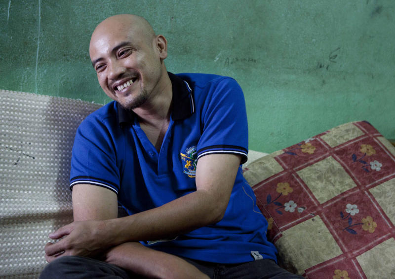 In this May 22, 2012 photo, Nazarrudin Saidin, who was recently released after being kidnapped in the Philippines about a year ago, smiles as he talks during an interview at his home in Sungai Buloh near Kuala Lumpur, Malaysia. The Malaysian gecko trader held captive by suspected Abu Sayyaf militants for a year says he saw teenagers as young as 15 skilled in using M16 rifles that seemed readily available in impoverished villages in the southern Philippines. (AP Photo/Mark Baker)