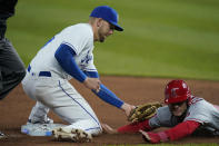 Los Angeles Angels David Fletcher, right, is tagged out by Kansas City Royals third baseman Hunter Dozier, left, during the ninth inning of a baseball game at Kauffman Stadium in Kansas City, Mo., Tuesday, April 13, 2021. The Royals defeated the Angels 3-2. (AP Photo/Orlin Wagner)