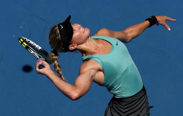 Eugenie Bouchard of Canada serves to Li Na of China during their semifinal at the Australian Open tennis championship in Melbourne, Australia, Thursday, Jan. 23, 2014.(AP Photo/Eugene Hoshiko)