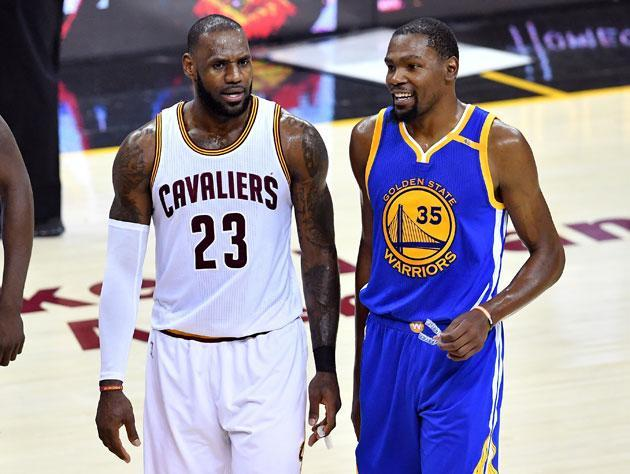 "LeBron James and <a class=""link rapid-noclick-resp"" href=""/nba/players/4244/"" data-ylk=""slk:Kevin Durant"">Kevin Durant</a> talk about what it's like to play defense in March. (Getty Images)"