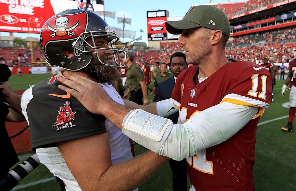 TAMPA, FL - NOVEMBER 11:  Ryan Fitzpatrick #14 of the Tampa Bay Buccaneers and Alex Smith #11 of the Washington Redskins shake hands during a game  at Raymond James Stadium on November 11, 2018 in Tampa, Florida.  (Photo by Mike Ehrmann/Getty Images)