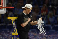 Stanford head coach Tara VanDerveer cuts down the net after the championship game against Arizona in the women's Final Four NCAA college basketball tournament, Sunday, April 4, 2021, at the Alamodome in San Antonio. Stanford won 54-53. (AP Photo/Morry Gash)