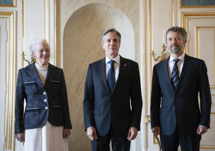 Denmark's Queen Margrethe II, left and Crown Prince Frederik, right, pose for a photo with US Secretary of State Antony Blinken, at Amalienborg Palace in Copenhagen, Denmark, Monday, May 17, 2021. Blinken is seeing Danish leaders as well as top officials from Greenland and the Faeroe Islands in Copenhagen on Monday before he heads to Iceland for an Arctic Council meeting that will be marked by his first face-to-face talks with Russian Foreign Minister Sergey Lavrov at a time of significantly heightened tensions between Washington and Moscow. (Saul Loeb/Pool Photo via AP)