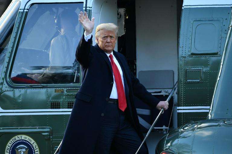 US President Donald Trump waves as he boards Marine One at the White House
