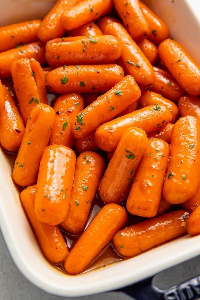 """<p>After tasting this buttery-sweet brown-sugar glaze, I'm sure it'll earn a permanent spot in your recipe box.</p> <p><strong>Get the recipe:</strong> <a href=""""https://40aprons.com/candied-carrots/"""" class=""""link rapid-noclick-resp"""" rel=""""nofollow noopener"""" target=""""_blank"""" data-ylk=""""slk:candied carrots"""">candied carrots</a></p>"""