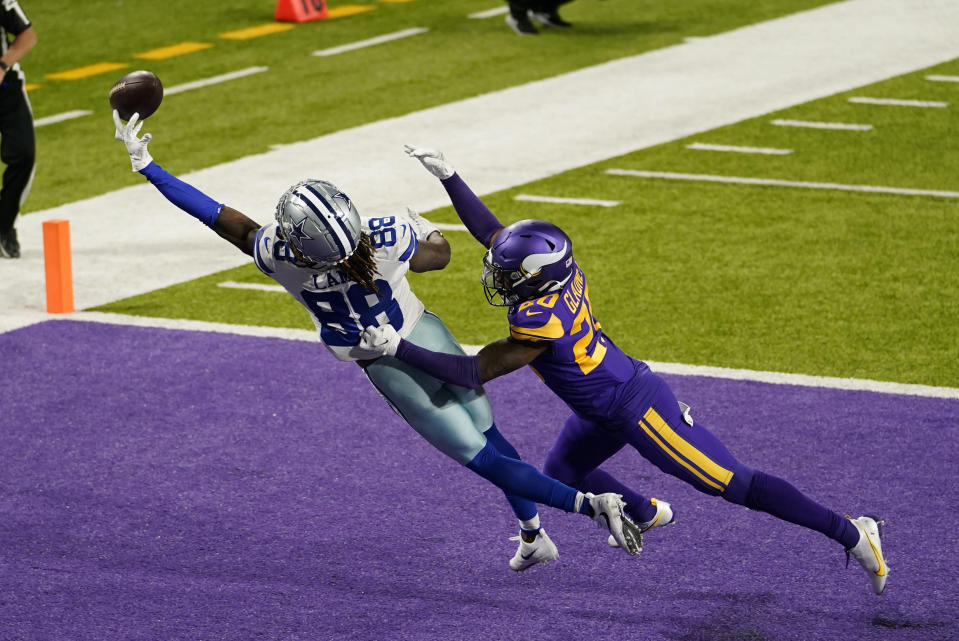 Minnesota Vikings cornerback Jeff Gladney (20) breaks up a pass intended for Dallas Cowboys wide receiver CeeDee Lamb (88) in the end zone during the first half of an NFL football game, Sunday, Nov. 22, 2020, in Minneapolis. (AP Photo/Jim Mone)