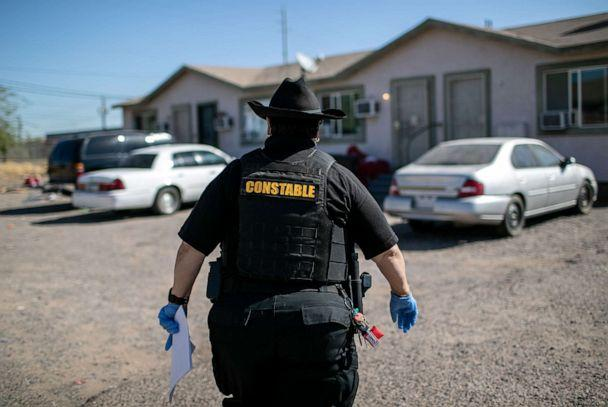 PHOTO: Maricopa County constable Darlene Martinez arrives to a home to post an eviction order on Oct. 1, 2020 in Phoenix. (John Moore/Getty Images)