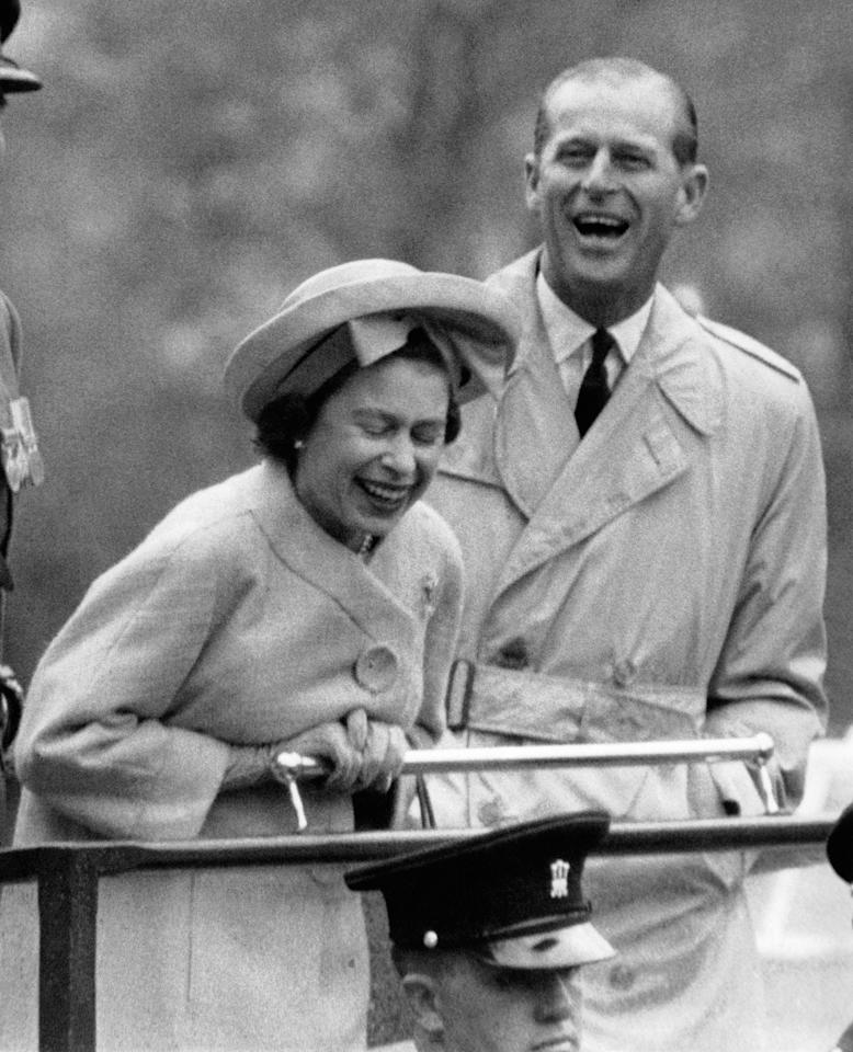 <p>Queen Elizabeth and her husband the Duke of Edinburgh are laughing at a rope acrobat performed by two young recruits during their visit to a military camp in Wales on 11 May 1963 in the United Kingdom. </p>