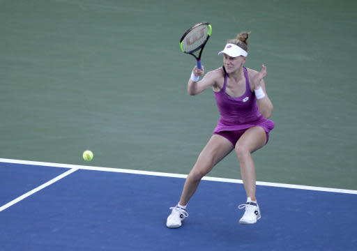 Alison Riske, of the United States, returns a shot to Jelena Ostapenko, of Latvia, during the second round of the US Open tennis championships Thursday, Aug. 29, 2019, in New York. (AP Photo/Adam Hunger)