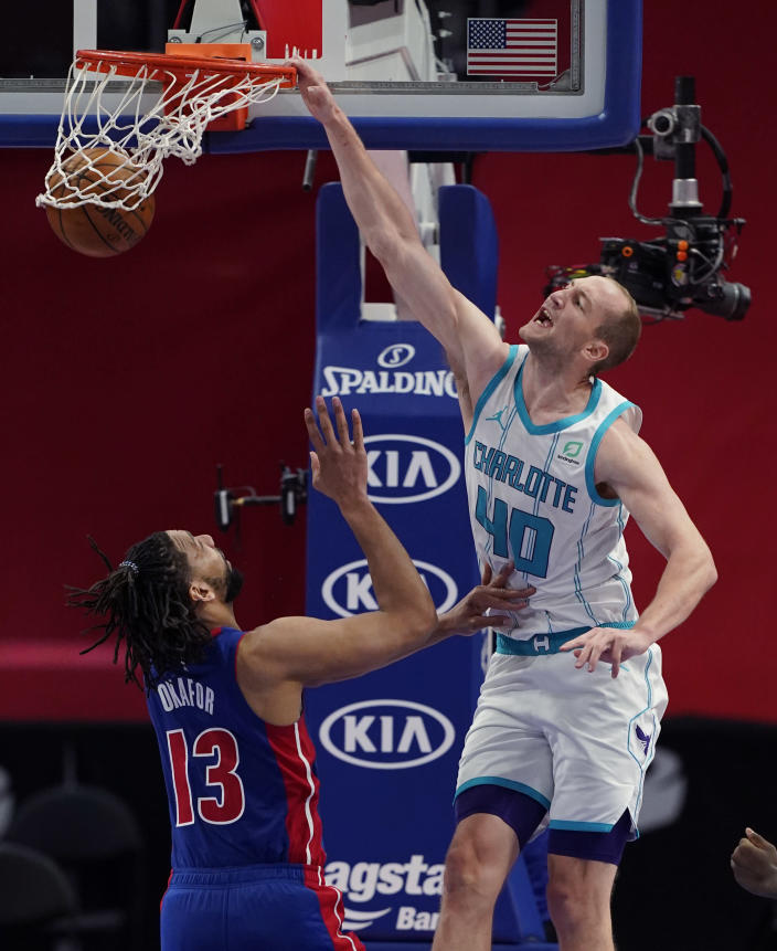 Charlotte Hornets center Cody Zeller (40) dunks on Detroit Pistons center Jahlil Okafor (13) during the second half of an NBA basketball game, Tuesday, May 4, 2021, in Detroit. (AP Photo/Carlos Osorio)
