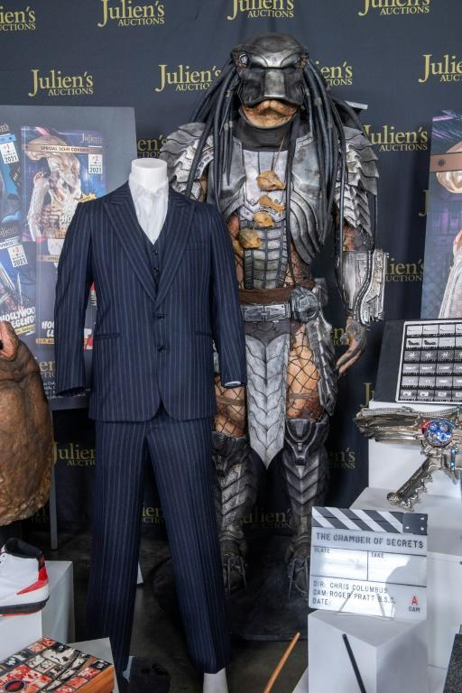 """Al Pacino's """"Tony Montana"""" screen-matched three-piece pinstripe suit from """"Scarface"""" and Ian White's Predator Costume from """"Alien vs Predator"""" are seen at the the auction preview in Beverly Hills, California, March 10, 2021"""