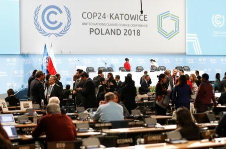 Participants take part in plenary session, during the final day of the COP24 U.N. Climate Change Conference 2018 in Katowice