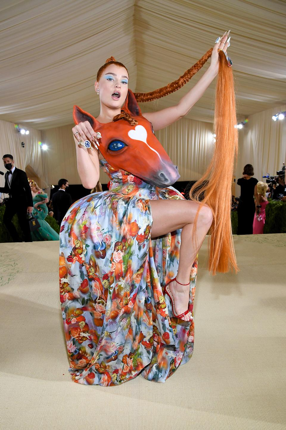 Kim Petras made an unforgettable debut at the Met wearing a horse headdress designed by sustainable New York brand Collina Strada. Fun and on theme!