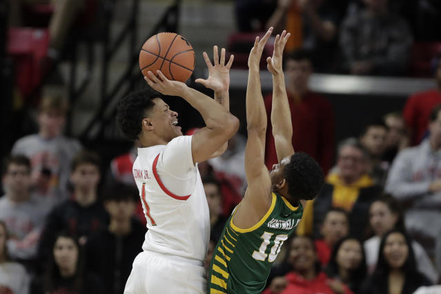 Maryland guard Anthony Cowan Jr., left, goes up for a shot against George Mason guard Jamal Hartwell II during the first half of an NCAA college basketball game Friday, Nov. 22, 2019, in College Park, Md. (AP Photo/Julio Cortez)