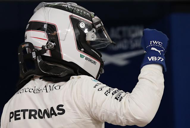 Mercedes' Valtteri Bottas celebrates after taking pole position (AFP Photo/Karim Sahib)