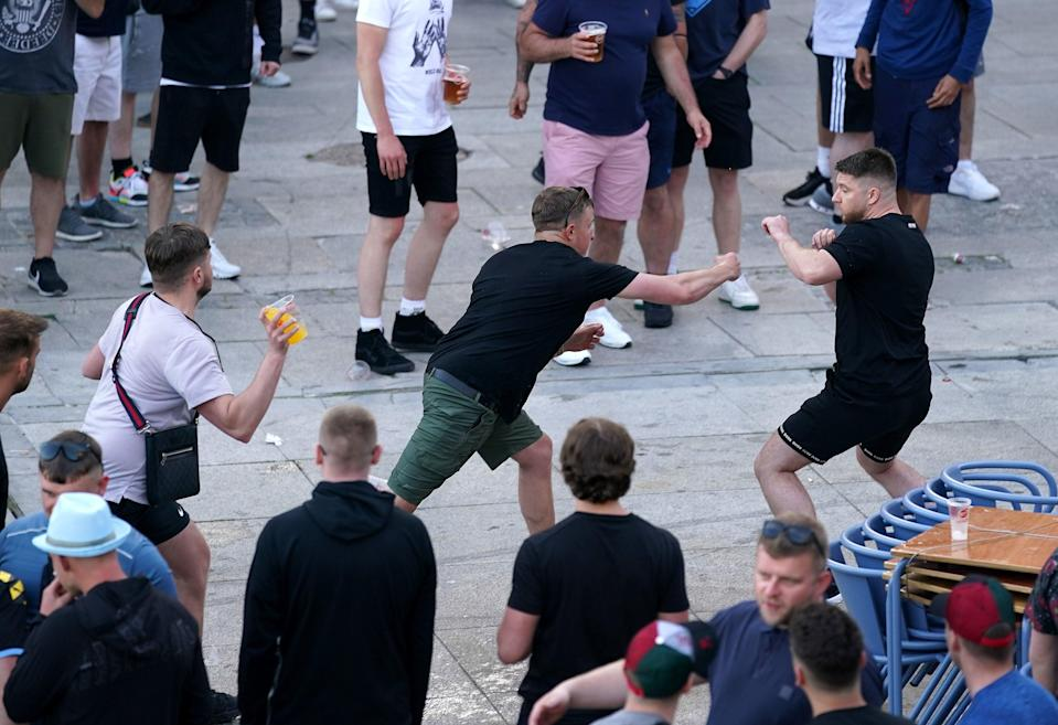 <p>Fans in Porto clash ahead of the Champions League final</p> (PA)