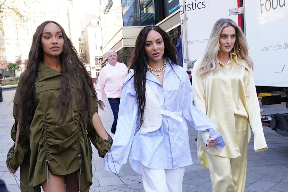 The members of Little Mix, (left to right) Leigh-Anne Pinnock, Jade Thirlwall and Perrie Edwards, arriving at the studios of Global Radio in London. Picture date: Friday April 30, 2021. (Photo by Yui Mok/PA Images via Getty Images)