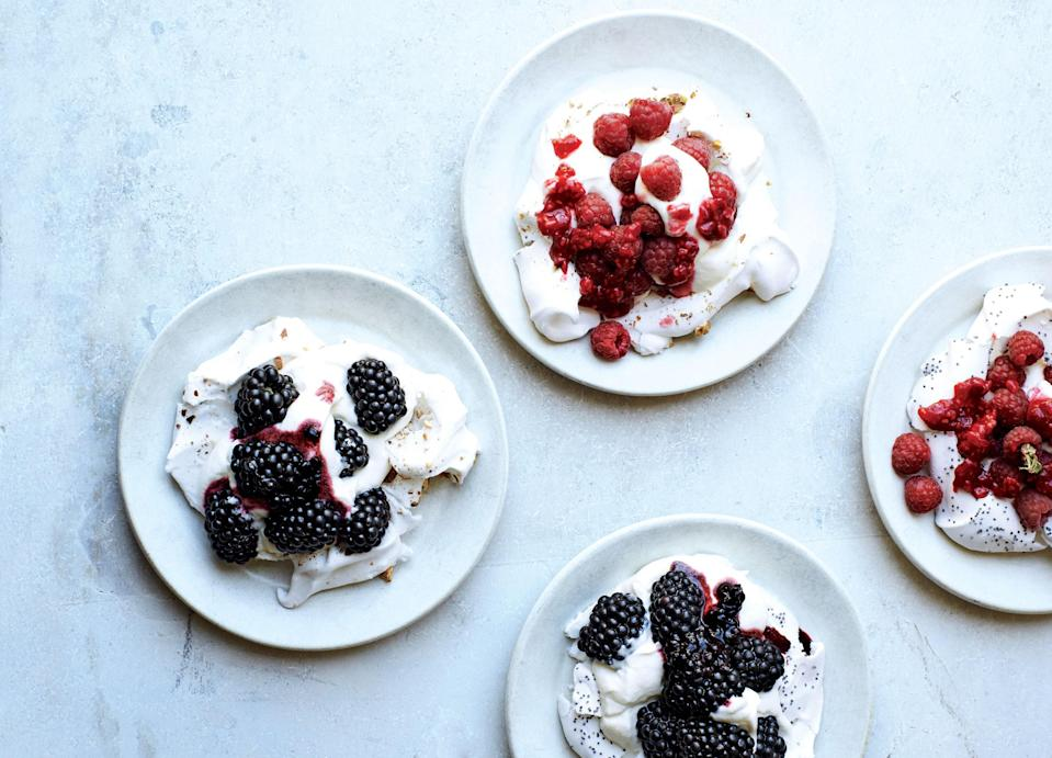 """Heating the sugar before beating it into the egg whites creates an extra-glossy, stable meringue. <a href=""""https://www.bonappetit.com/recipe/pavlovas-with-fresh-berries?mbid=synd_yahoo_rss"""" rel=""""nofollow noopener"""" target=""""_blank"""" data-ylk=""""slk:See recipe."""" class=""""link rapid-noclick-resp"""">See recipe.</a>"""