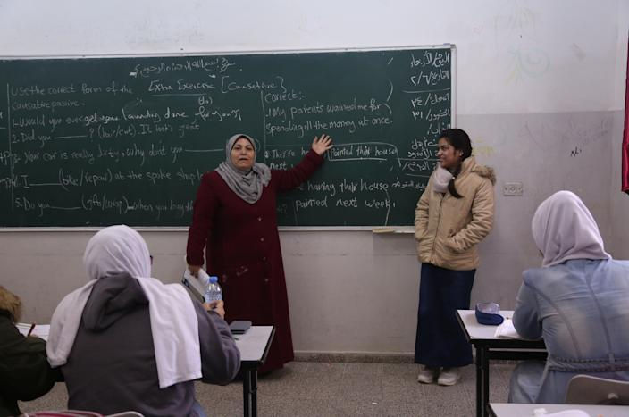 Fatma Youssef, right, stands at the front of the class during an English language lesson at her school in Gaza City on Feb. 7, 2019. (Photo: Samar Abo Elouf/Reuters)