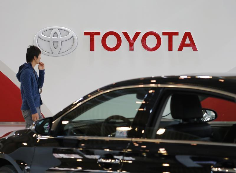 A man walks past Toyota Motor's logo at the company's showroom in Tokyo