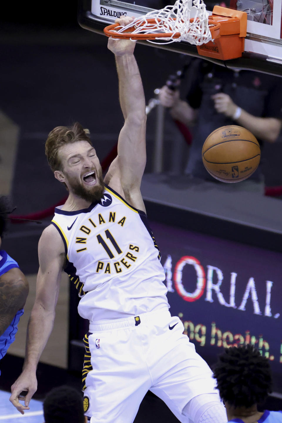 Indiana Pacers' Domantas Sabonis dunks during the fourth quarter against the Houston Rockets in an NBA basketball game Wednesday, April 14, 2021, in Houston. (Carmen Mandato/Pool Photo via AP)