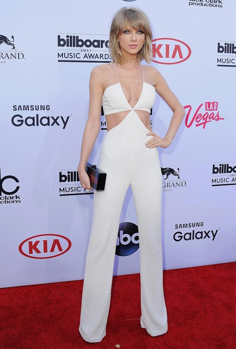 """<p>Swift turned heads in this edgy, chic jumpsuit during the 2015 Billboard Music Awards, where she performed her hit song """"Bad Blood."""" (Photo: Jon Kopaloff/FilmMagic) </p>"""
