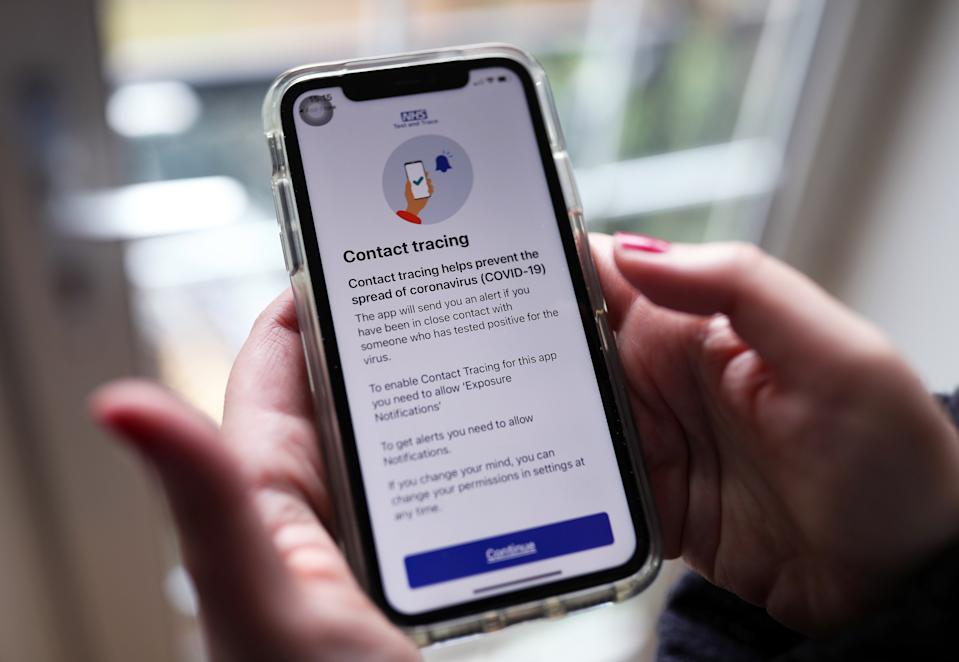 The new coronavirus contact tracing app on an iPhone, which was launched across England and Wales on Thursday morning. (Photo by Yui Mok/PA Images via Getty Images)