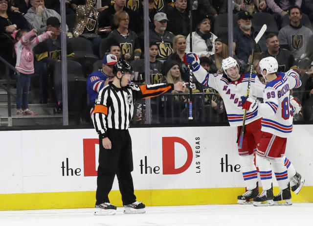 New York Rangers defenseman Jacob Trouba and right wing Pavel Buchnevich (89) celebrate after Trouba scored against the Vegas Golden Knights during the second period of an NHL hockey game Sunday, Dec. 8, 2019, in Las Vegas. (AP Photo/Isaac Brekken)